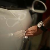 Porsche junto a relojes Chopard
